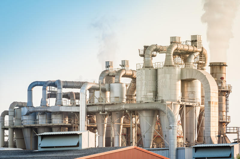 Industrial plant of a furniture factory. Chemical plant for the processing of chipboard of a furniture factory stock photo