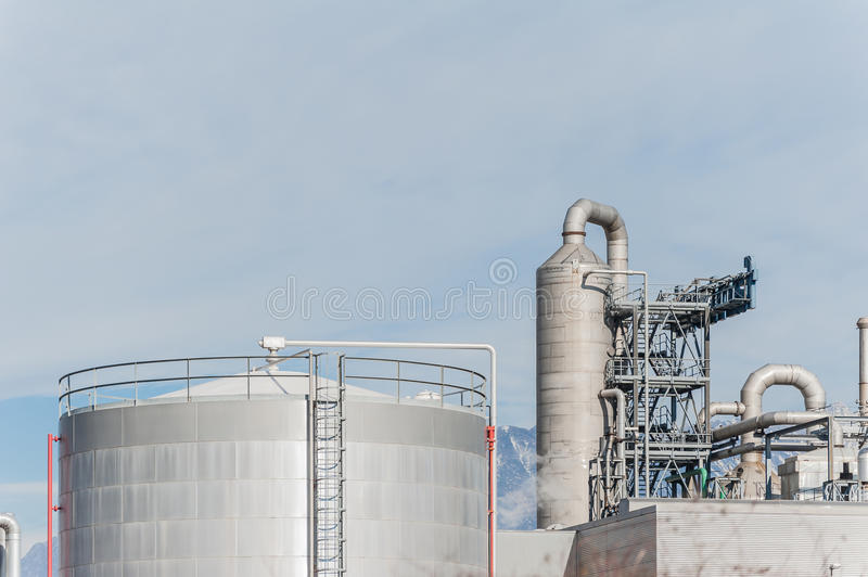 Industrial plant of a furniture factory. In the foreground one tank paraffin royalty free stock photo