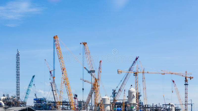 Industrial plants are currently under construction. With many tower cranes and worker stock image
