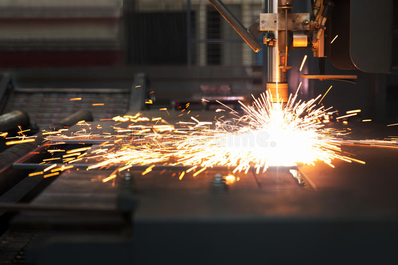 Industrial plasma cutting of metal plate. Industrial cnc plasma cutting of metal plate royalty free stock images