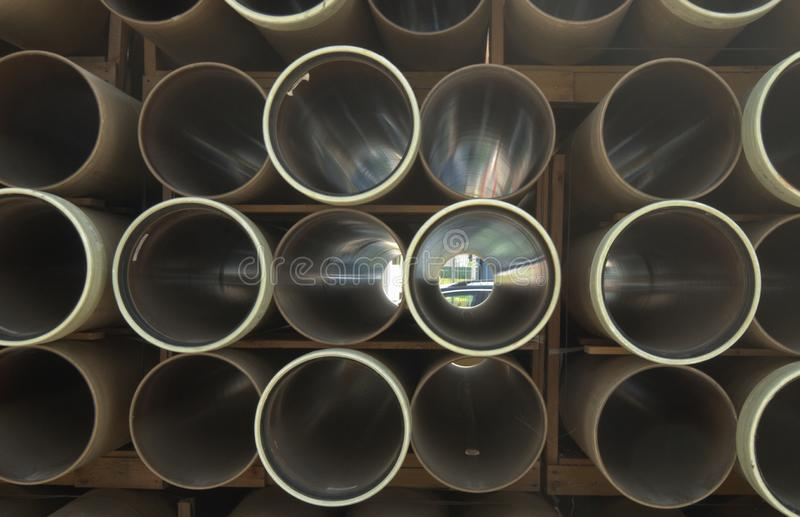 Plastic tubes stack pile stock images