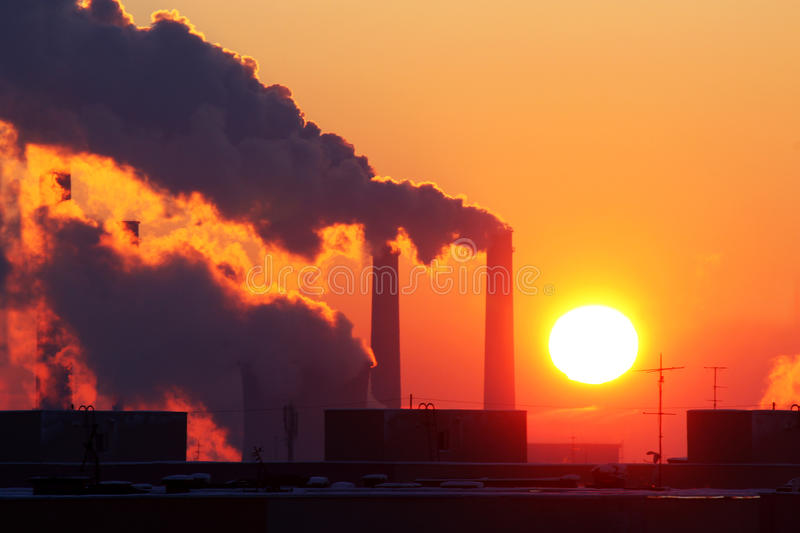 Industrial pollution at sunset stock photography