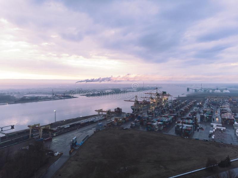 Industrial port with containers. Overhead drone footage of shipping containers with transport network trucks. Import, export royalty free stock photo