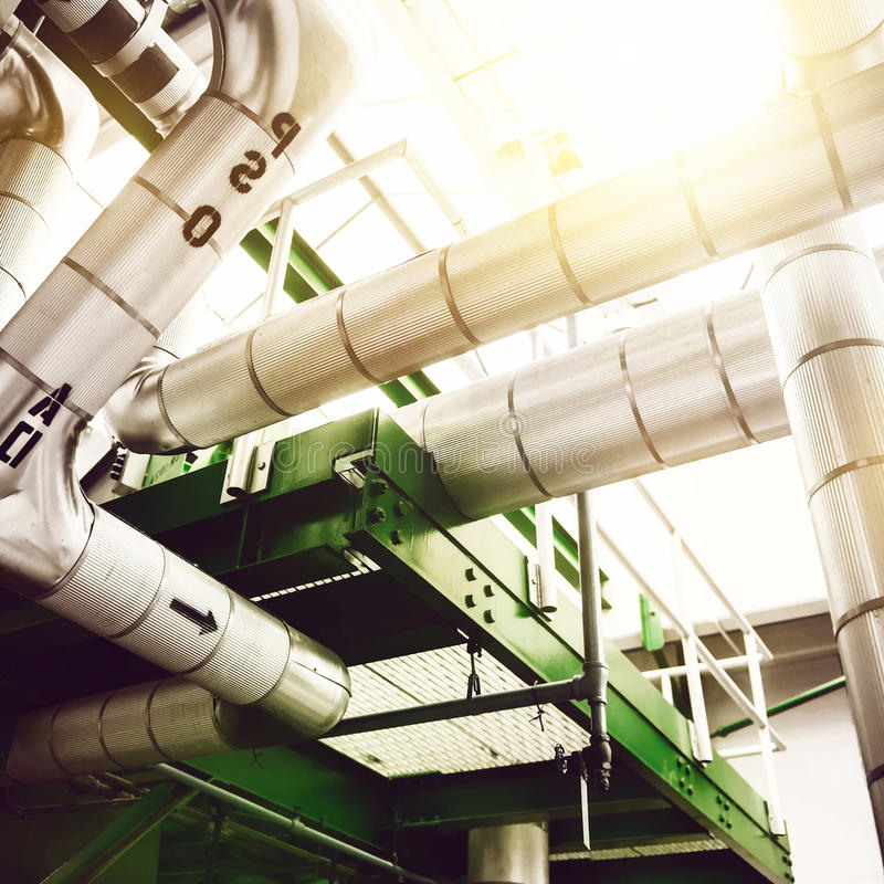 Industrial power generation plant factory with high pressure steam pipes and valves. royalty free stock images