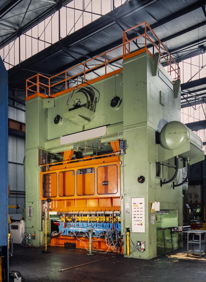 Industrial press for sheet metal stamping stock images