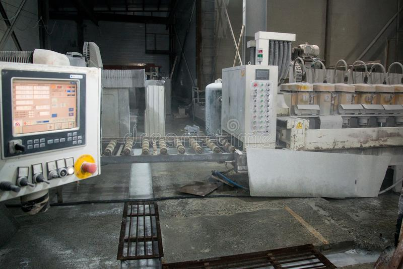 Industrial processing of natural stone. Dashboard in production stock image