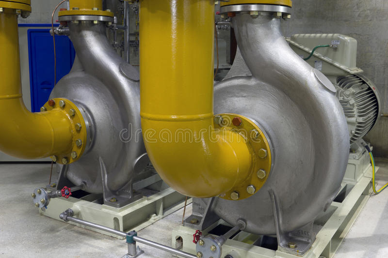 Industrial pumps. Oil circulating pumps in industrial process royalty free stock photography