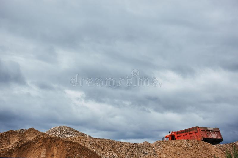 Industrial quarry with mountains of sand, gravel and dump truck royalty free stock photo
