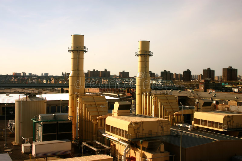 Industrial Queens, New York. Aerial View of Industrial Factory Chimneys in Queens, New York with Enormous Apartment Buildings in Background stock image