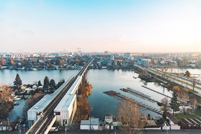 Industrial railway station rustic dock urban aerial top view photography of outskirts landmark district near Vienna capital of. Austria, horizon morning sun stock photography