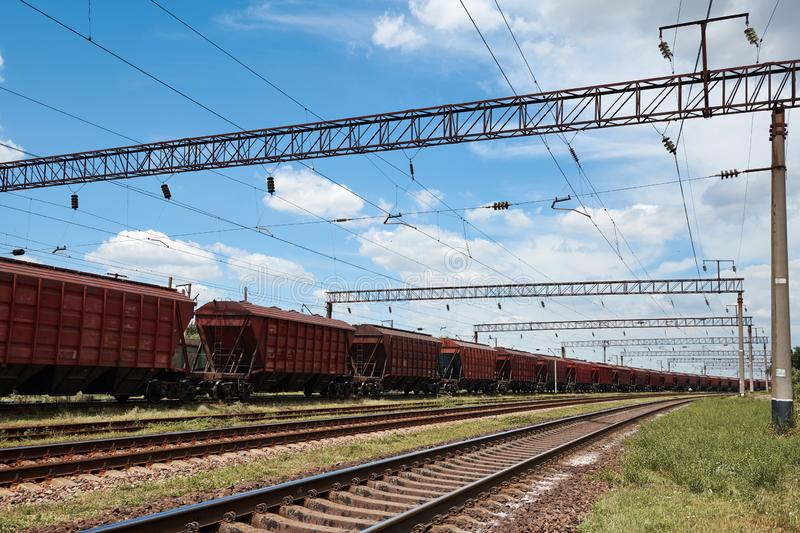 Industrial railway - wagons, rails and infrastructure, electric power supply, Cargo transportation and shipping concept stock images