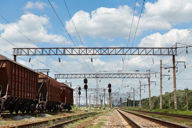 Industrial railway - wagons, rails and infrastructure, electric power supply, Cargo transportation and shipping concept royalty free stock images