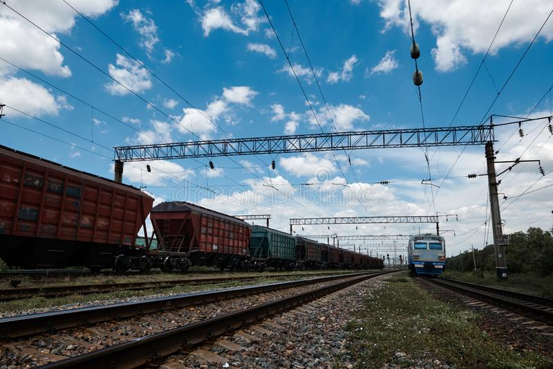 Industrial railway - wagons, rails and infrastructure, electric power supply, Cargo transportation and shipping concept royalty free stock photography