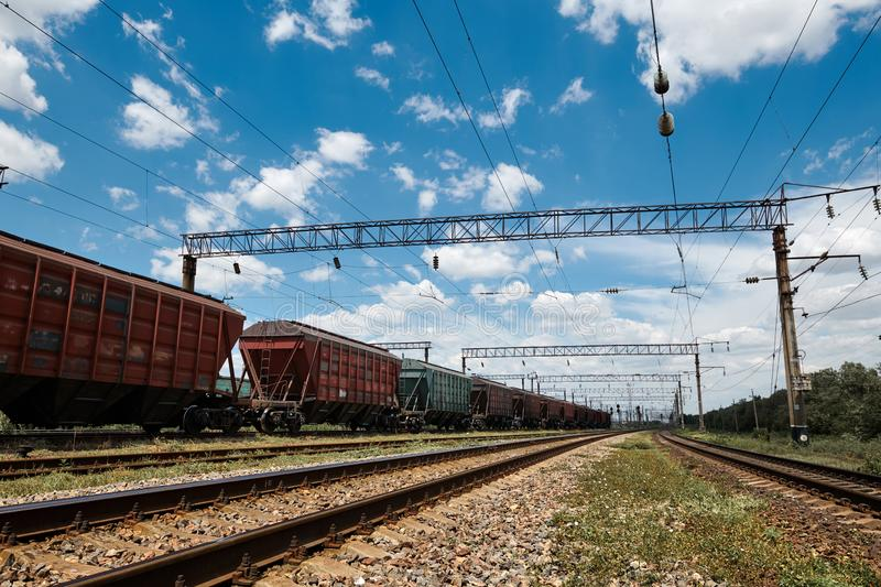 Industrial railway - wagons, rails and infrastructure, electric power supply, Cargo transportation and shipping concept stock image