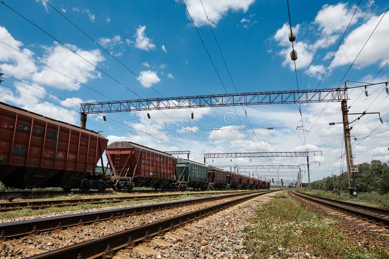 Industrial railway - wagons, rails and infrastructure, electric power supply, Cargo transportation and shipping concept stock photo