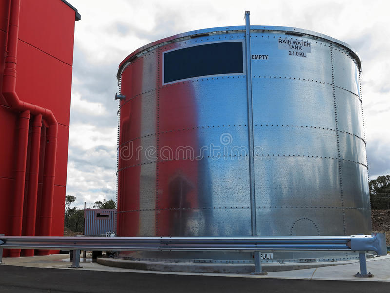 Industrial rain water tank. A modern rainwater tank for an industrial area in the countryside. Australian rainwater harvesting industry royalty free stock photo