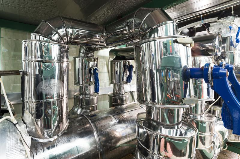 Industrial refrigerating machine, system of heat-insulated pipelines. stock images