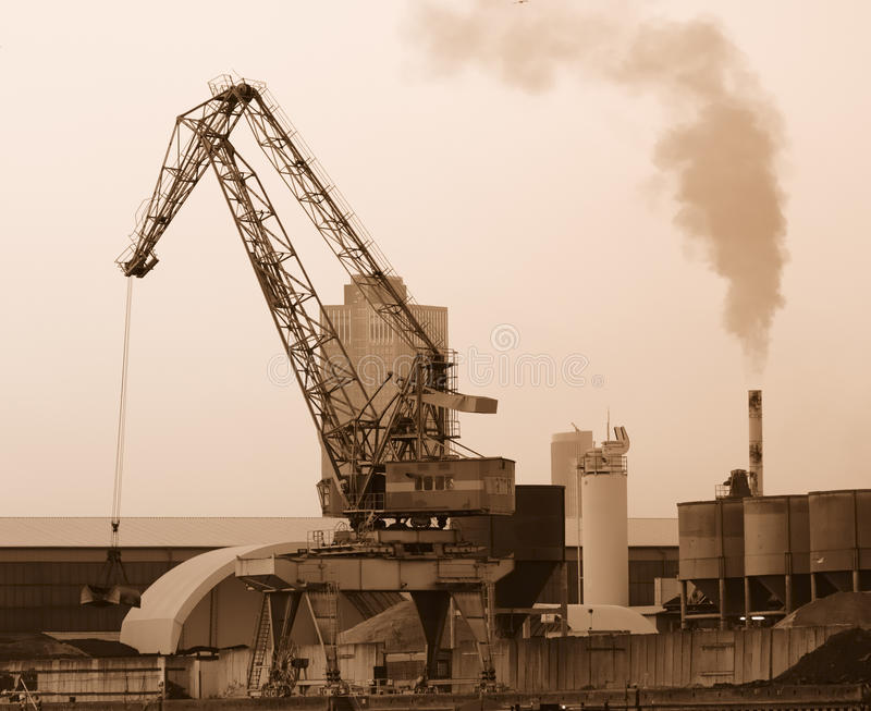 Industrial Revolution. Cran on an old industrial site royalty free stock photography