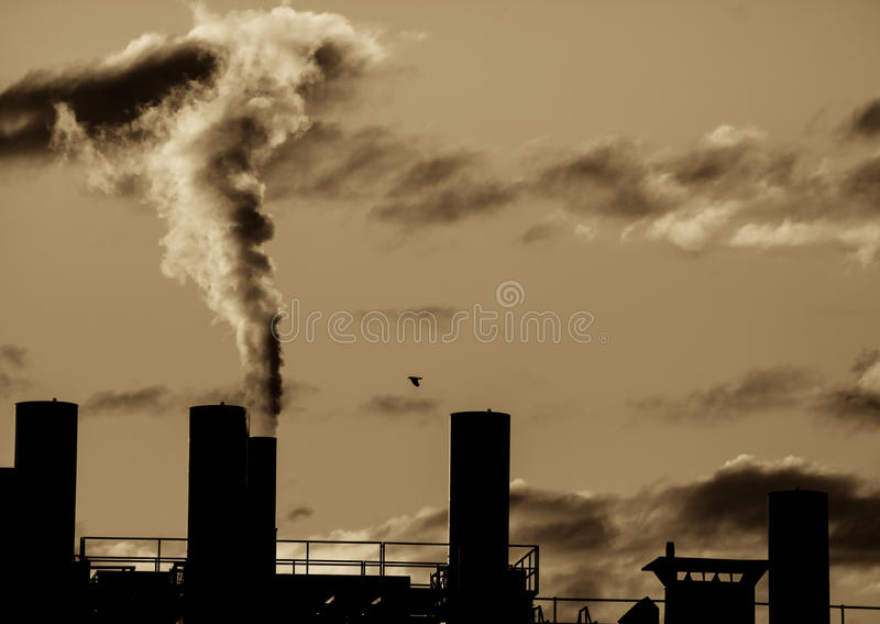 Industrial Revolution. Old industrial site polluting the air with dark smoke stock images