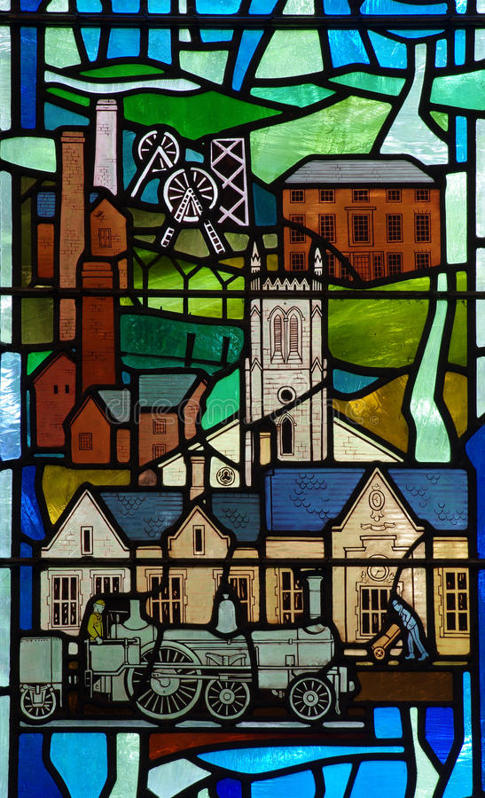 Industrial revolution in stained glass. A photo of the Industrial revolution in stained glass stock image