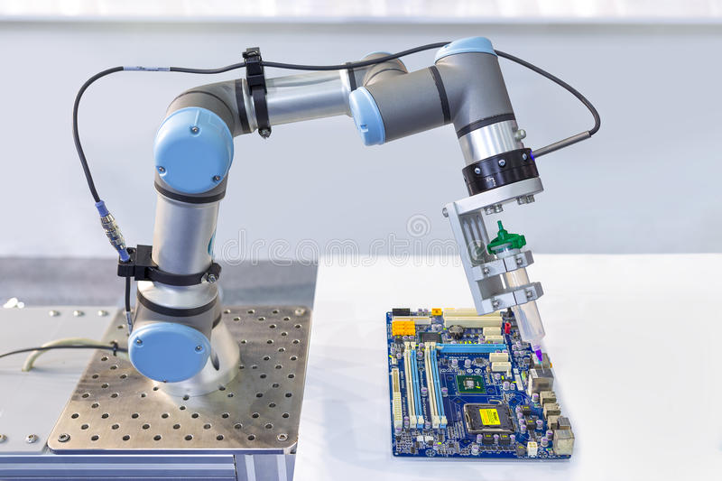 Industrial robot installing a computer chip at production line i royalty free stock image