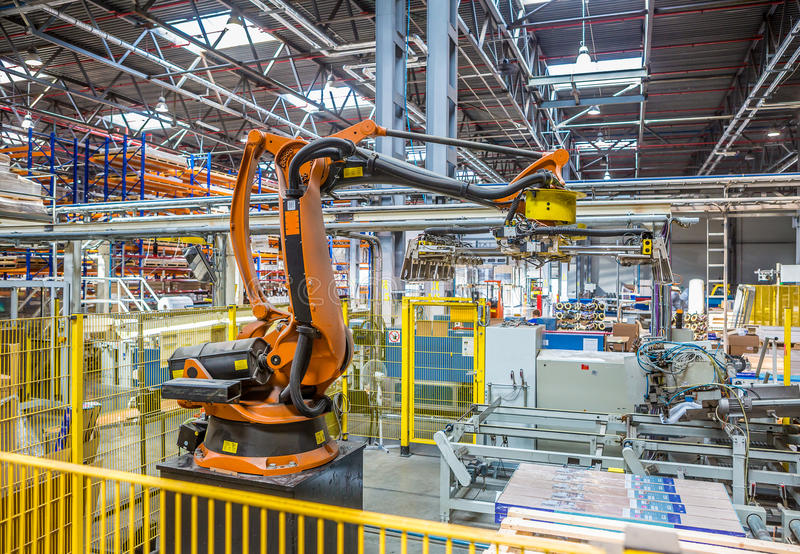 Industrial robot packer in the workshop production stock photos
