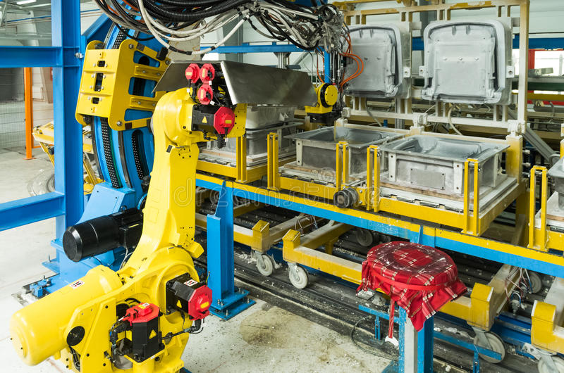 Industrial robot. On production line for foam