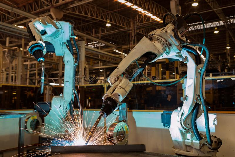 Industrial robot are test run new program in automotive assembly stock images