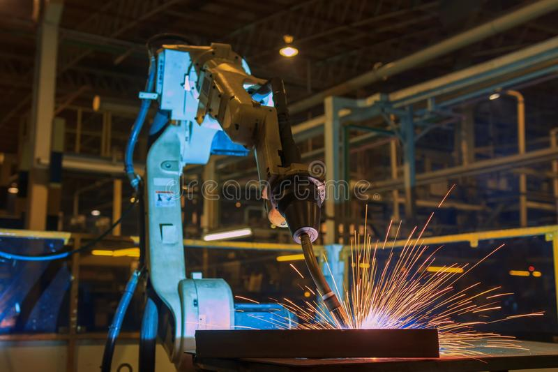 Industrial robot is test run new program in automotive factory stock photo