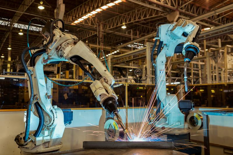 Industrial robot are test run new program in automotive factory. They are test new progran stock photo