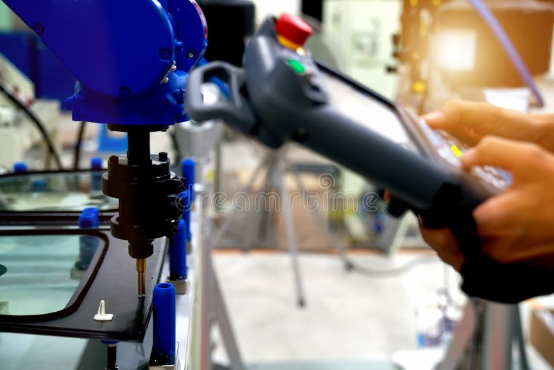 Industrial robot welding automotive part in car factory stock photography