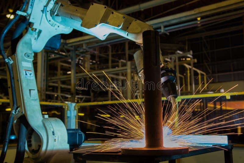 Industrial robot is welding automotive part in factory. Industrial robot is welding assembly automotive part in car factory royalty free stock image