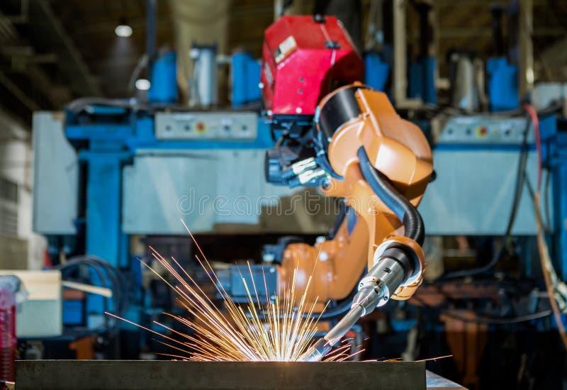 Industrial robot is welding part in automotive industrial factory. Industrial robot is welding part in automotive line factory royalty free stock image