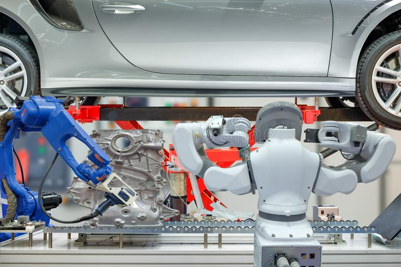 Industrial robotic teamwork working with auto parts for maintain car royalty free stock photos