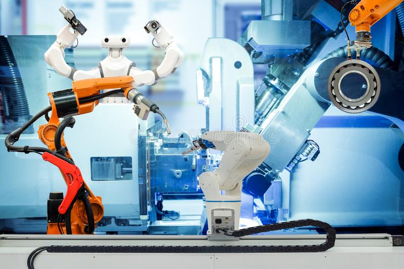 Industrial robotic teamwork working on smart factory 4.0 concept. Industrial robotic welding, robot gripping and smart robot working on smart factory, on machine stock images