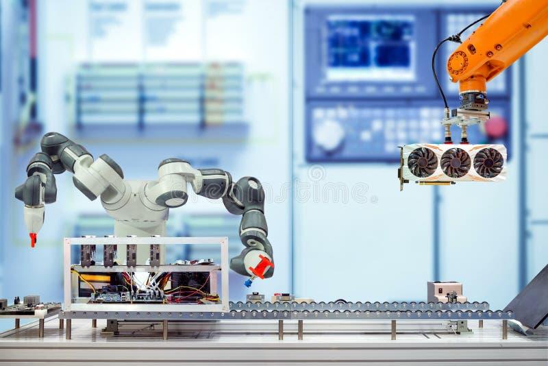Industrial robotics working assemble computer bitcoin mining via conveyor belt on smart factory royalty free stock photography