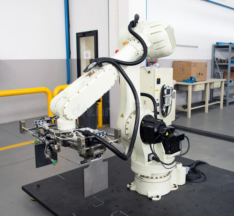 Industrial Robots - Automation lines. Industrial automation lines with robots stock photos