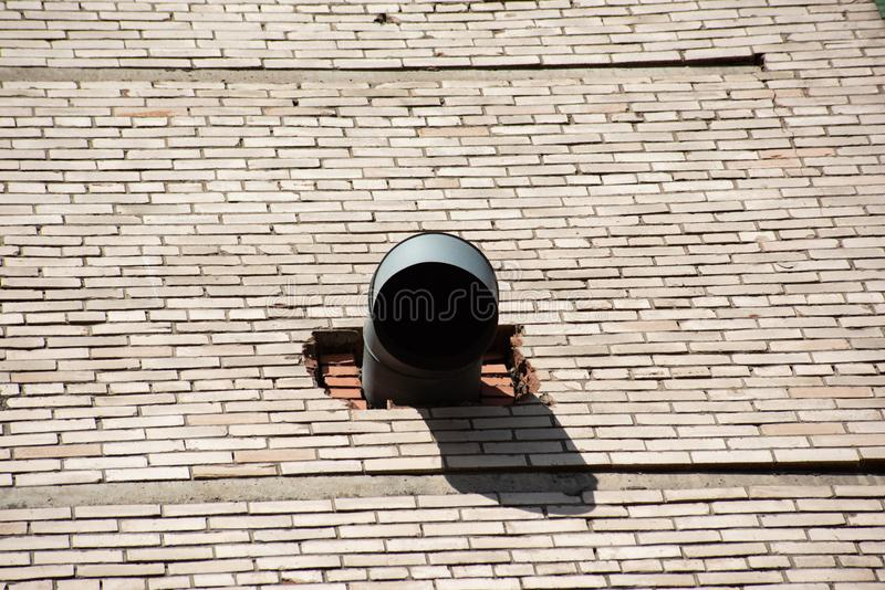 Industrial round hood in a brick wall royalty free stock image