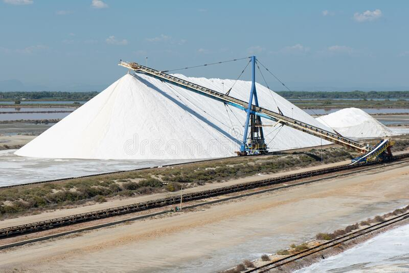 Industrial salt production in Aigues-Mortes, Gard department, Lanquedoc-Roussillon region, Camargue, France. Industrial salt production in Aigues-Mortes, Gard stock image