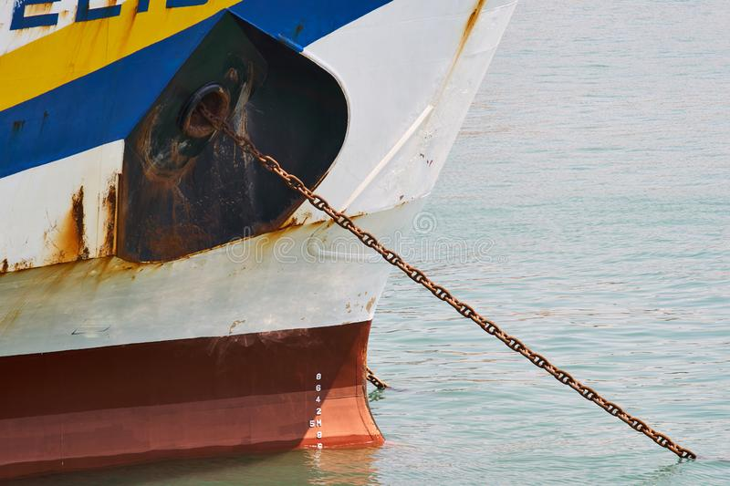 Industrial Ship Bow With Rusty Anchor Chain royalty free stock photo