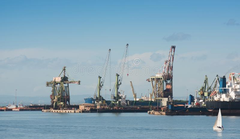Industrial shipping cranes in the port of Taranto, Italy. Puglia stock images
