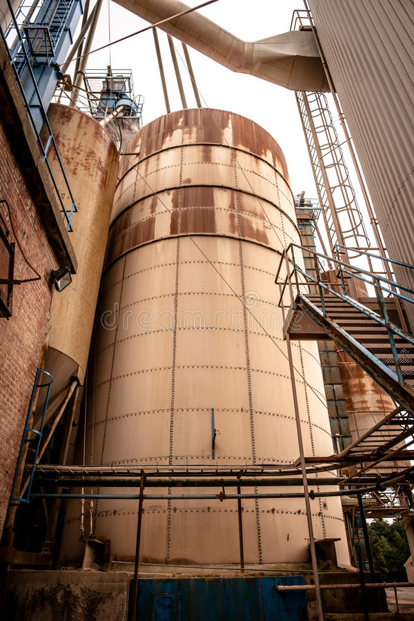 Industrial silo. S in a old rusty inviroment royalty free stock photo