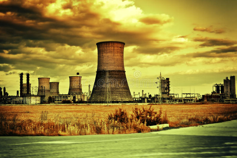 Industrial site and cloudy landscape stock image