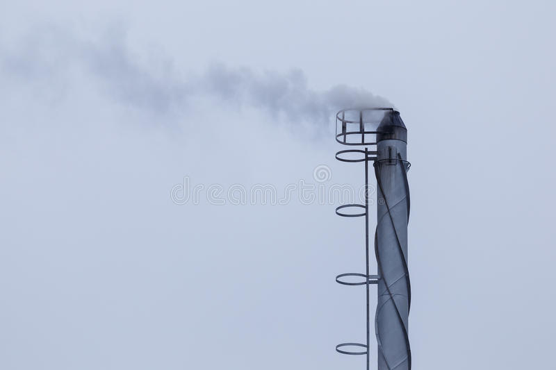 Industrial smoking chimney. And cloud stock photo