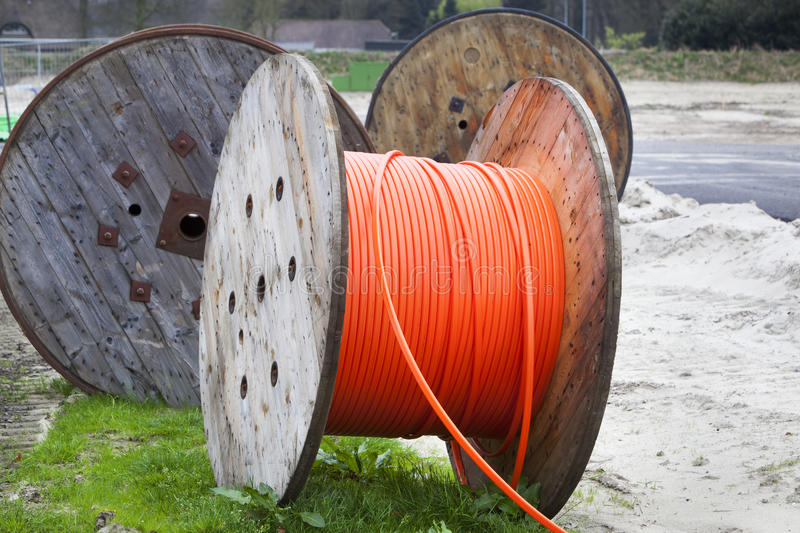 Industrial spools with cable. Industrial spools with orange cable in the Netherlands stock images