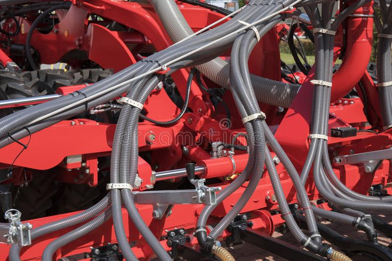 Industrial springs on agricultural transportation and equipment. Element. Red painted metal, iron, part, steel, machinery, heavy, industry, mechanical, spiral royalty free stock images