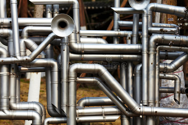 Industrial stainless steel pipe work. Shot of industrial stainless steel pipe work royalty free stock photo