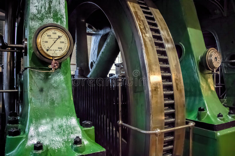 Industrial steam engine fly wheel. royalty free stock image