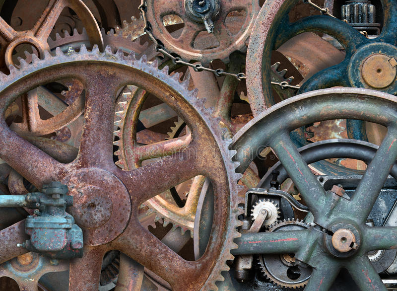 Industrial Steampunk Background, Gears, Wheels. Grunge gears and wheels create an industrial steampunk background. Rust colors from the parts can be seen royalty free stock photos