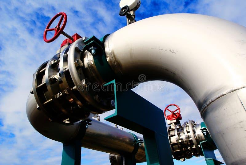 Industrial Steel pipelines valves blue sky stock photos